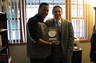Attorney Smith with Mr. Carlos Gonzalez-Megret, a client who was acquitted of all charges.  Mr. Gonzalez-Megret is presenting Attorney Smith with a specially engraved clock commemorating their victory.  They remain in touch to this day.