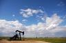 Blue skies, oil well, and green fields