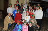 2010 Mascagni Law Office sponsored a Christmas party for the Wayside Christian Mission Women and Children's Shelter. Pictured above is Frank Mascagni as Santa and his office staff and their family members as elves.