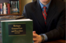 Posing with a copy of the Michigan OWI Handbook for lawyers that I wrote in 2009 for West Publishing. This was for the cover of MI Lawyers Weekly. The MLW featured a case of mine that changed the way the Michigan State Police analyzes blood in OWI cases.