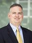 North Carolina Licensing Attorney Russell M. Racine