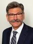 John E. Kusturiss Jr.