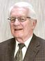 Brian L Comstock